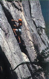 A climber take a hold at one of the White Mountains many climbs