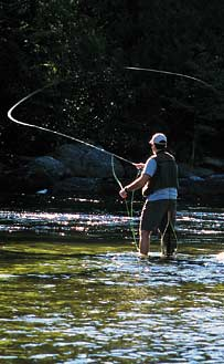Fly fishing in the outdoors of the White Mountains